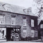 Alfred Wells shop in Knight Street. Gertrude Wells, died on her 13th birthday on the 13th July 1913. her brothers Frank and Seymour are also in he picture. The old 'Candle House' is on the far right