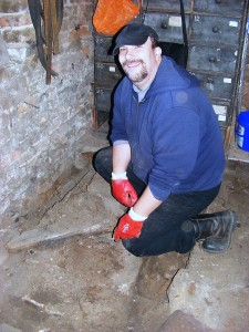 Richard Buck excavating in the small store - 25 November 2011