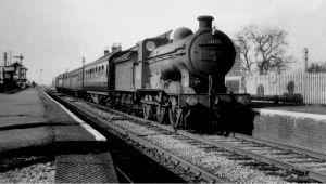 AOS P 2785  twenty railway station, J6 No'64172 heading east. 1950s