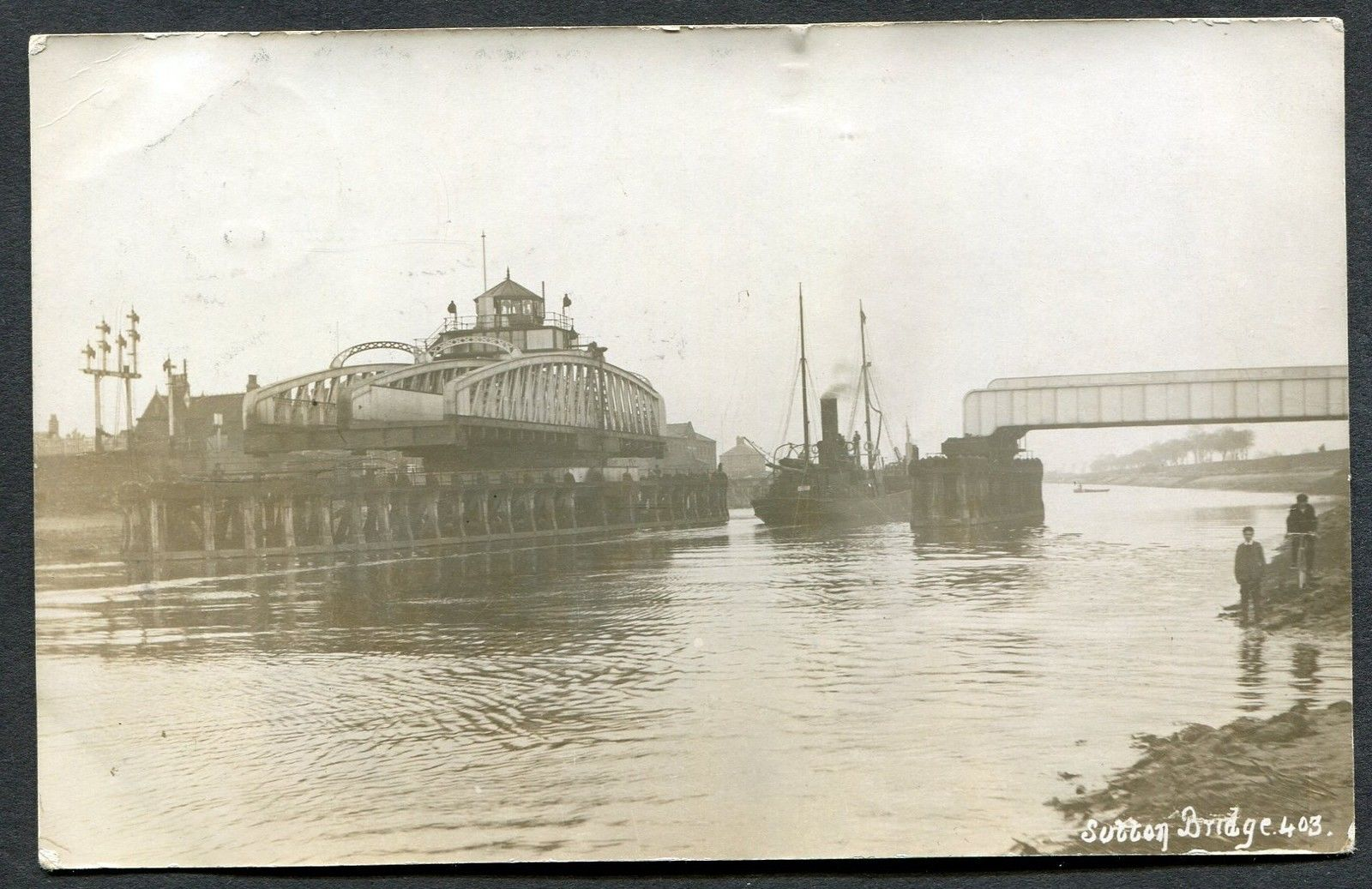 Sutton Bridge with boat passing through