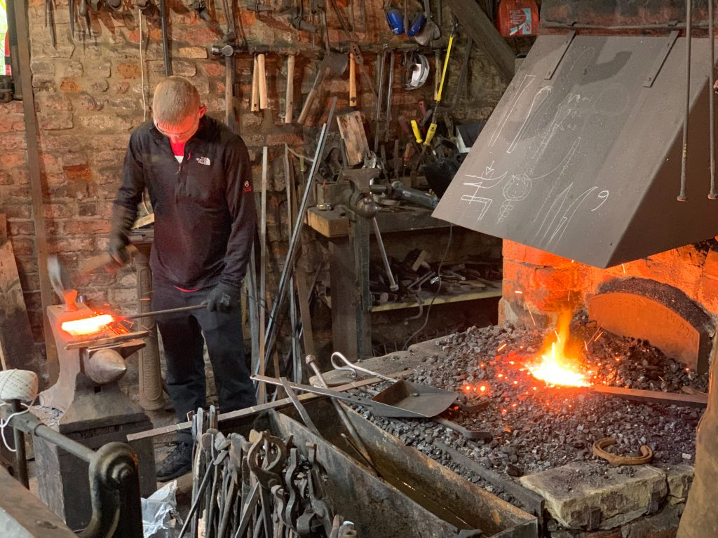 Blacksmith working at Spalding Chain Bridge Forge